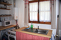 Kitchenette with gas-fired hot water, gas hob and oven, microwave, coffee pod machine